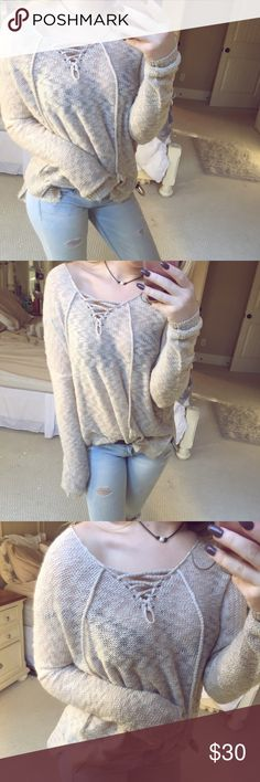 oatmeal knit lace up sweater gorgeous oatmeal colored knit sweater. features a super hipster lace up neck that adds so much character to the sweater. slightly oversized for a more comfortable, laid back look. size medium/large •• not listed brand! used for exposure ☕️ Free People Sweaters