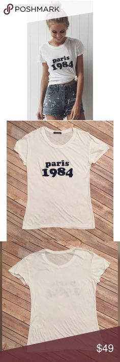 Brandy Melville Paris 1984 Velvet T-Shirt One Size Brandy Melville Paris 1984 Velvet White Short Sleeve T-Shirt One Size  ▫️Paris 1984 is in blue Velvet  ▫️No stains ▫️No holes  ▫️Measurements in photos  For the best deal, I offer a bundle discount! Please check out my closet for other fabulous items! Brandy Melville Tops Tees - Short Sleeve