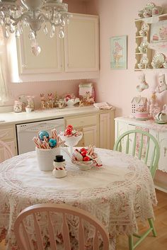 Such a cute, pretty little kitchen.  Love the chandelier, but dunno I want to have to keep that sucker clean in a cooking environment.... bedroom, okay, but kitchen? Hmmmm.... #pastel #kitchen