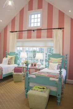 What a fun kids room - love the striped walls and the turquoise beds!