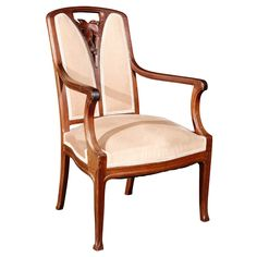 Art Nouveau armchair in the manner of Majorelle  France  Circa 1900  A graceful Art Nouveau armchair. Wood is mahogany and chair is covered in a muted salmon chenille. Hand carved leaf and berry detail to the backrest.