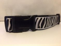 Very fashionable Zebra printed dog collar. Can be set on white or black backing. Very cute and sparkly material used.  $5 from every sale will go to
