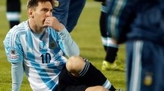 Losing feeling: Lionel Messi watches  Chile raise the Copa America trophy.