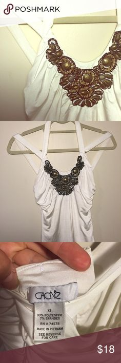 Cache White & Gold Beaded Tank Super cute for the summer time! For fitting and classic looking. The beading really gives this an edge while providing some sophistication. The straps are unique yet a little discolored from make up use as seen in picture above. In good used condition otherwise! Tops Tank Tops