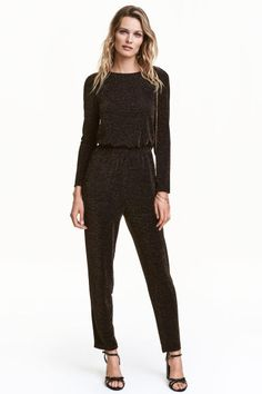 Glittery jumpsuit: Jumpsuit in glittery jersey with a draped neckline at the back with a cut-out section above the waist, long sleeves, an elasticated seam at the waist and tapered legs. Lined at the top.