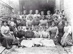 checkout the fashionable hairdos of the sacking girls in Brick Lane (London's East End), this pic was taken about 1906.