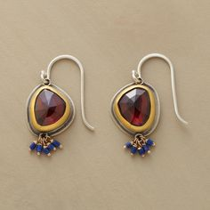 """EYE OF THE TIGER EARRINGS--In these Ananda Khalsa garnet and lapis earrings, irregular facets imbue claret-colored garnets with an all-seeing quality, as if peering in every direction at once. The stones are rimmed in matte 22kt gold, backed in sterling silver. Tiny, hand-cut lapis beads cluster below. Handmade in USA. Sterling silver French wires. 1""""L."""