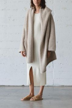 - All time favorite hooded alpaca coat from Lauren Manoogian - Blanket like soft texture - Relaxed, oversized fit - Open front with shawl - Two front pockets - 93% baby alpaca, 7% polyamide - Made in