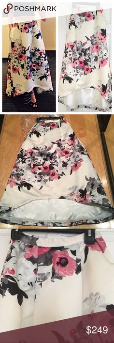 💞HP💞 Parker Lenore Floral Satin Skirt SIZE 0 🔅 Neimans - $396 retail. Worn once then dry cleaned. LIKE NEW condition 🔅 Satin w/thin tulle layer & fully lined. Hidden side zipper. 100% Ivory w/black, grey, & occasional pink flowers🔅I 💜 this skirt, wore it to a warm Fall wedding & got so many compliments. Tailored into a high low (last photo shows post/pre); now the front of the dress hits just at the ankle (show off your shoes! 😉) And it has pockets! 🙊 I can talk about this skirt ALL…
