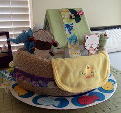 Noah's Ark Diaper Cake.  Instructions on web.