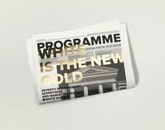 Newsprint with gold foil print finish designed by Tomat.