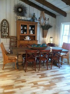 Dinning room decor. A long harvest table that seats 8