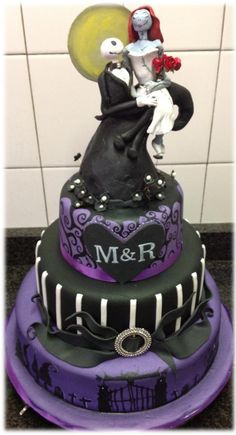"Other / Mixed Shaped Wedding Cakes - This was a wedding cake for a couple who wanted a ""nightmare before Christmas"" theme and I believe I fulfilled the brief.  The topper was made from air drying clay as they wanted to keep it for posterity.  The rest of the cake was top tier fruit, middle tier dummy and bottom tier chocolate mud cake."