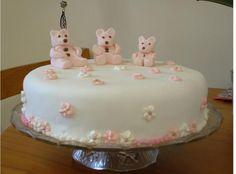 Round Christening in white with small pink teddy bears photos
