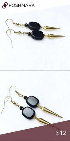 Black spike handmade earrings by jules jewelry box Fashionable black spiky earrings that are hand made by Jules Jewelry Box. These earrings measure approximately 1 1/2 inches in length. They have gold tone findings with a smooth black Czech focal bead. Jules Jewelry Box  Jewelry Earrings