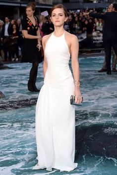 Who: Emma Watson  Wearing: Ralph Lauren CollectionWhere: U.K. premiere of Noah Why We Love It:  A tight, white gown is never easy to pull off — but you would never know it looking at Watson at the British premiere of Noah. At 23, the actress looks sophisticated and chic — yet still fresh-faced and completely age-appropriate.