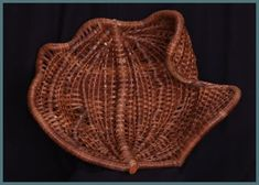 Brown Seashell, a bowl by master basket weaver Tina Puckett