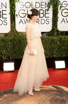 Zooey Deschanel in Oscar de la Renta this evening at the 2014 Golden Globes.   Her pearl and crystal embroidered gown and pearl embroidered pump are from our spring 2014 collection.