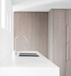White kitchen, wooden panels