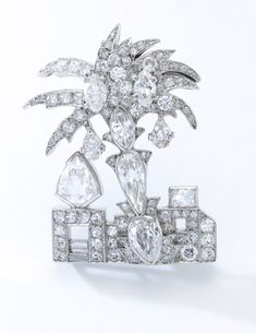 Diamond brooch, Cartier, late 1920s Designed as a palm tree set with briolette, pear-, marquise-shaped, circular-, single-cut and baguette diamonds, signed Cartier, numbered.