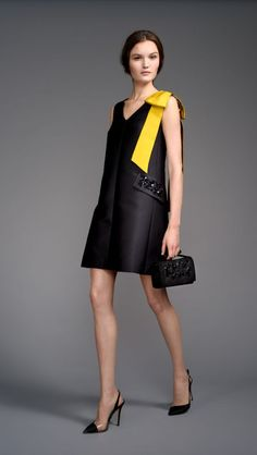 Gorgeous black dress with bright yellow bow.