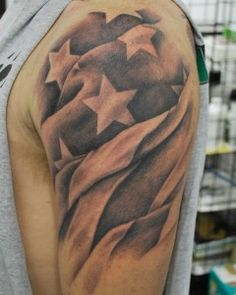 American flag upper arm tattoo