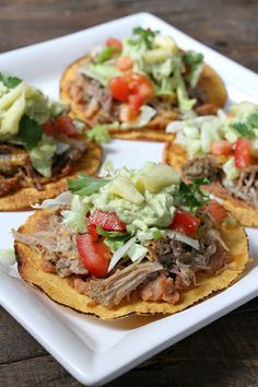 Carnitas Tostadas with Pineapple Guacamole - recipe from RecipeGirl.com : this is the best dinner recipe for your family- always a hit!