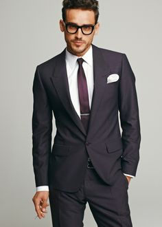 Simple well tailored single button charcoal suit with a touch of personal flair with the purple button and stitching. Great look for dealing with VC's.