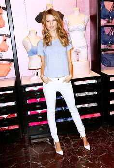 Behati Prinsloo in grey T-shirt, white jeans and white pointy-toe heel