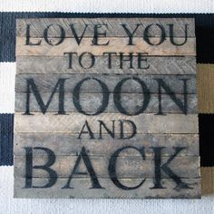 """Handcrafted wall art created from repurposed wood salvaged from Wisconsin farms is stenciled 'Love you to the moon and back.'    14"""" square.    Reclaimed tobacco-lath wood."""
