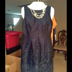 """Formal Evening/Cocktail Dress Beautiful and Elegant Formal dress.   Blue color with dazzling effects that make this dress glow.  Good condition with normal wear.  Size 8.  70% Polyester and 30% Rayon.  Arm to arm laying flat is """"16.5.  The length of this dress is """"33.  Non smoking home CDC Petites Dresses"""