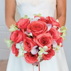 The bridal bouquet included coral roses, white orchids, and light pink mini calla lilies.