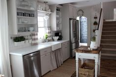 """The owner-remodelers of this charming country-style kitchen purchased the 100-year-old farmhouse at a real estate auction. Check out the """"befores"""" and prepare to be amazed at their handiwork."""