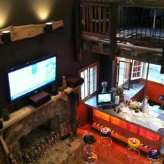 Cool home decor with fireman pole from bedroom to bar!