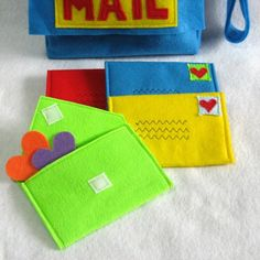 Felt mail bag for the kids- the mail bag could be attached to a page, the individual letters/envelopes could come out. It would be cute if you had a notebook and pen on the page next to it to write their own letters.