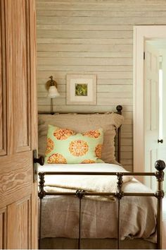 Rustic Bedroom with overhead reading lamp.