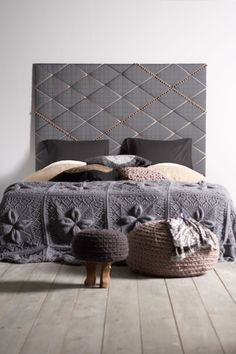 This is really a beautiful headboard.  I love the criss-cross effect from the tufting.  For chilly nights, throw a gorgeous blanket ~ Molitli ~ at the end of the bed.