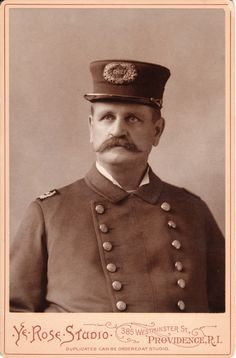 This excellent image is a portrait of a fire chief in Providence, Rhode Island. He is seen in his dress uniform with a fire chief badge on his hat. His coat buttons indicate he is a fireman with the Providence Fire Department.  The photographer is Y. E. Rose of Providence, Rhode Island. The studio opened in 1886 in the Conrad Building.