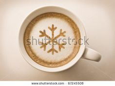 christmas snow flake , drawing on latte art coffee cup - stock photo