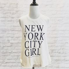 New York City Girl Mussel Tank A Brandy Melville Mussel Tee. Never been worn and still with tag. My price is firm. No trades. Brandy Melville Tops Tank Tops