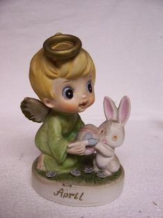 vintage hand painted April Angel figurine  -with little angel boy, bunny and easter egg, marked April  -measures approx. 4 tall and 3 wide  -marked with C--0046  -unsure of maker, likely Lefton or Napco  -good condition, no chips or cracks  -an Illinois estate find  -I am told this one is on the rare side - harder to find!     Please see my etsy shop for 1200 vintage items in many different categories:  http://www.etsy.com/shop/FabVintageEstates
