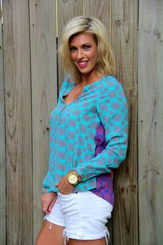Love the patterns and the mix of colors on this great comfy and flattering top!