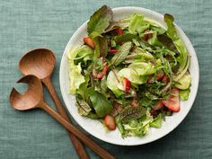 Green Salad with Strawberry Balsamic Vinaigrette via Food Network  Ingredients  2 teaspoons strawberry jam 1 tablespoon balsamic vinegar 3 tablespoons extra-virgin olive oil, eyeball it Salt and pepper, to taste 1 pint strawberries, sliced 4 to 5 cups chopped romaine or mixed greens of any kind