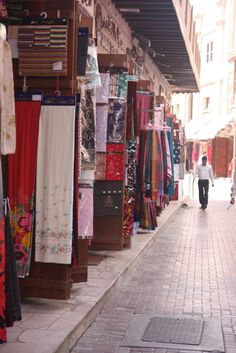 Textile Market at Old Souk Deira, Dubai. Love all the colors and fabrics!! I wanna buy them all!