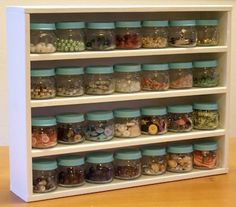 Baby food jars to store odds and ends. Tops painted the same to make it look cleaner.