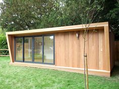 Pinnacle garden room with cedar cladding, graphite double sliding door set and air conditioning unit, from plus VAT. Used as a chillout room and lounge. Backyard Office, Backyard Sheds, Garden Office, Outdoor Garden Rooms, Garden Spaces, Contemporary Garden Rooms, Garden Cabins, Summer House Garden, Cedar Cladding