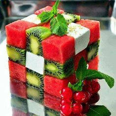Tasty Rubik's cube  Ingredients (1 cube): 100 g low fat feta 1-2 kiwi fruit 150 g watermelon  Directions: Peel the kiwi fruit Cut the kiwi fruit, watermelon and low fat feta in ferfect cubes Make a Rubik's cube with the cubes  Nutrtitional facts (1 cube) Energy: 236 cal Protein: 21 g Carbohydrates: 15 g (Sugar 13 g = fruit) Fat: 9 g (saturated 1 g) Fiber: 2 g