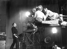 """""""Singin' in the Rain"""" - Gene Kelly sings and prepares for the """"Broadway Melody"""" number with director of photography and camera operator."""