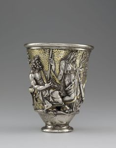 "Beaker with Imagery Related to Isthmia and Corinth. Dedicated by Quintus Domitius Tutus. Inscribed: ""MERCVRIO Q DOMITIVS TVTVS VSLM"", Roman, A.D. 1-100. Silver and gold; H: 12.5 cm; Diam: 10.3 cm; Wt: 463 grams. Modiolus. Poseidon (Neptune) and Demeter (Ceres). Bibliothèque nationale de France, Département des monnaies, médailles et antiques, Paris. VEX.2014.1.10"