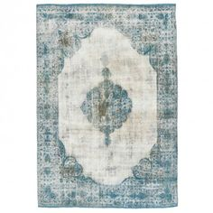 Color Reform Overdyed Rug  Intricately handwoven in Turkey using centuries-old techniques, this one-of-a-kind vintage rug features a traditional medallion in soft ivory and cobalt hues.